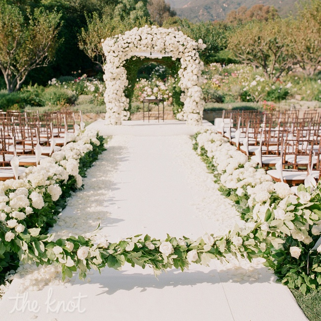 An abundance of all-white garden roses covered the huppah for an incredibly romantic focal point that still felt natural in the outdoor setting.