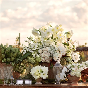 Planner Sarah Miller delivered the day's elegantly relaxed vibe by combining rustic touches with opulent statements: lush roses and hydrangeas filled up terra-cotta urns; delicate orchids mixed with quirky succulents.