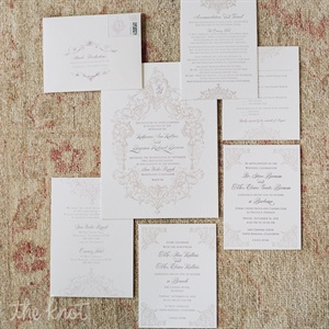 A mix of script and block fonts framed by an ornate twirling design gave the classic invitation suite a fresh feel.