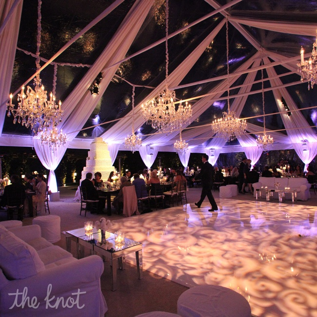 """The best way to wow guests is to let the beauty of nature take over,"" says Sacks. ""Plus, it costs nothing."" To create the feeling of dining under the stars, she draped the ceiling with white chiffon that opened up to the sky."