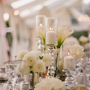 "Candles of varying heights interspersed with all-white monobotanical arrangements of peonies (one of the bride's favorite flowers), hydrangeas and calla lilies added visual depth to the tablescapes. ""Smaller, varied arrangements evoke a quiet, understated elegance,"" Sacks explains. ""If everything in front of you is the same level, it falls flat."""
