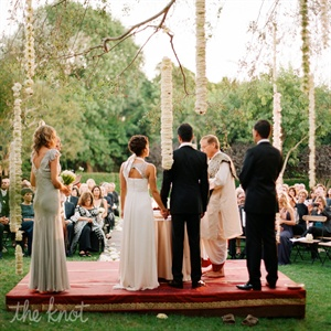 "For this wedding, Oren took inspiration from the joining of Saree's and Sidh's two cultures (Jewish and Hindu) and the California locale. ""I wanted to give them a beautiful, Western home garden wedding—with a twist of Indian culture,"" she says."