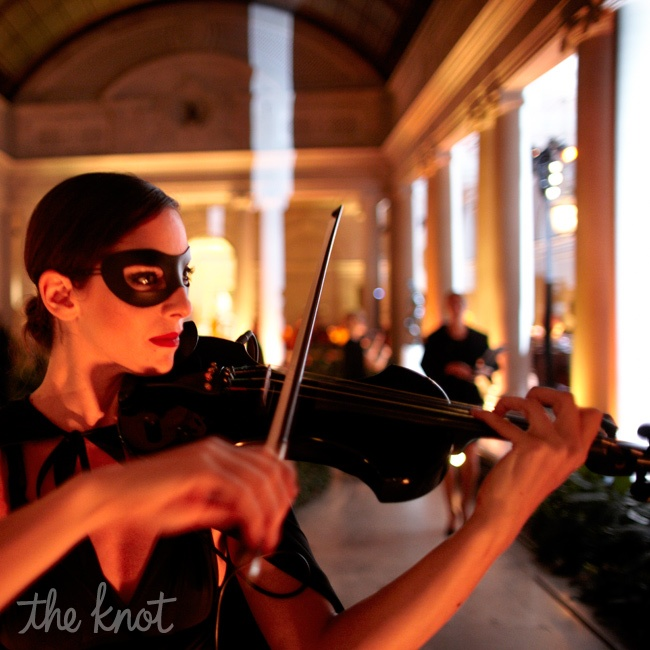 By playing up a few obvious references, like the masks and the mysterious black-clad caped musicians who performed at dinner, Rafanelli immediately developed a very specific picture. Whether it's far-out or more classic, think of a theme, he says, as a 