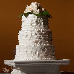 Courtney and Trey chose a three-tiered cake with fondant ruffles as the design with peonies on top of leaves as the cake topper. They chose vanilla as the cake flavor with cream cheese icing. Instead of a groom's cake they had pies from a shop the family frequently visits.