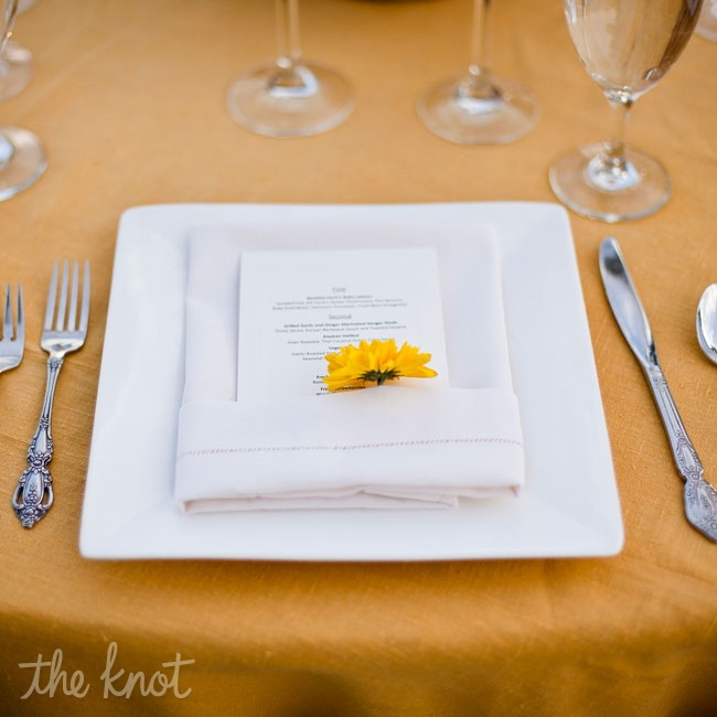 The table setting was square while plates that were accented with a simple sunflower tucked into the folder napkin and menu. Rachel originally wanted fresh herbs but the single flower made for a colorful compliment to the table linens.