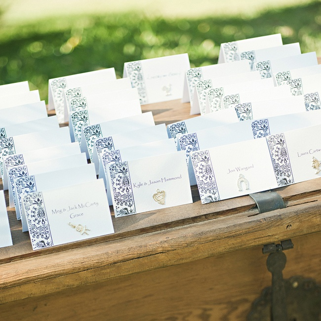 The escort cards were handmade by Lindsay's mom, Peggy Austin, who incorporated local tradition by decorating them with small religious folk charms, called Milagros. Each Milagros has a different meaning, symbolizing things such as safe travels and good health
