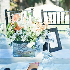 Lindsay and Brady chose lush white, green and orange flowers in square, low vases as their centerpieces.