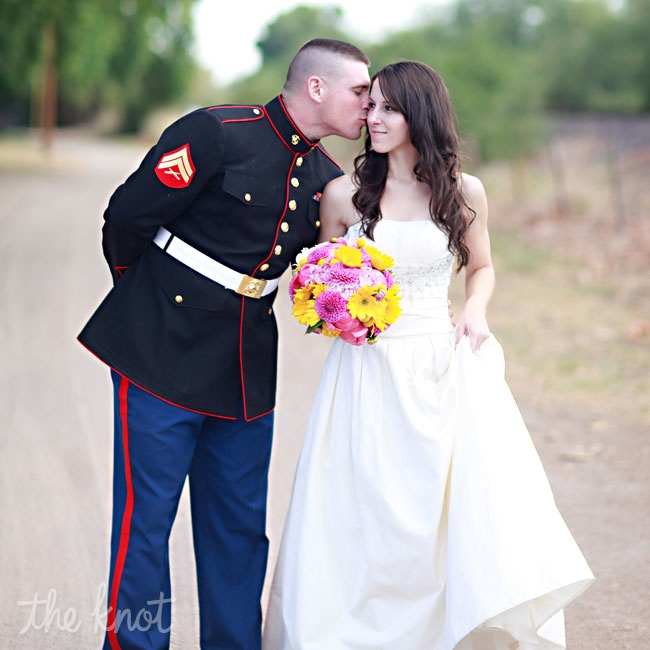 Gracie knew she wanted to look beautiful and feel comfortable on her wedding day and wanted her dress to be ivory and have a sweetheart neckline. Gracie wore a modified sweetheart neckline, ivory organza and strapless gown from Priscilla of Boston. It was the second dress she tried on! Jim wore his dress blues (USMC) and with a family line of marin ...