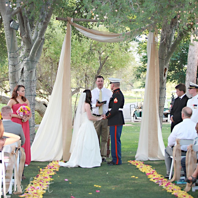 Gracie and Jim had their ceremony outside under the trees at the Otero Lawn, shortly before sunset, where Gracie's dad walked her down the aisle. They created an altar space by draping muslin fabric from the trees and lined the aisle to the altar with pink and yellow roses. They chose to use the traditional vows but made a few changes to them to ma ...