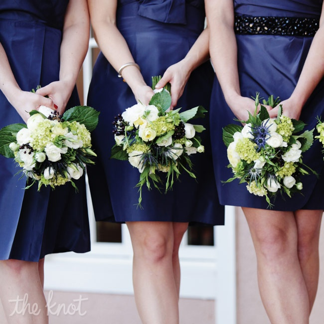 The blue thistles in the bridesmaids' natural arrangements were the ideal complement to their navy dresses.