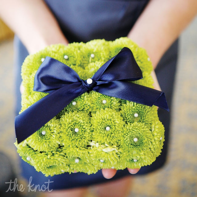 Green mums put a natural spin on the traditional ring pillow. Royal-blue ribbon added a regal touch.