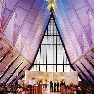 The unique, soaring glass ceiling of the Air Force Academy Cadet Chapel stole the show at the couple's late-afternoon vows.