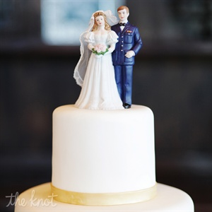 A retro topper in the likenesses of the couple decorated the simple three-tiered cake.