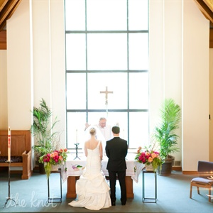 The church&#39;s floor-to-ceiling windows flooded the altar with natural light at Kate and Phil exchanged vows.