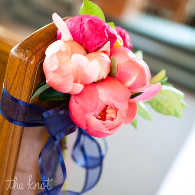 Small bunches of pink blooms added a burst of color to the church pews.