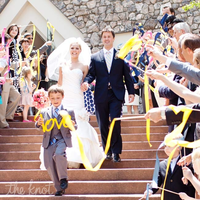 Guests lined the steps and waved colorful streamers as Kate and Phil exited the chapel.