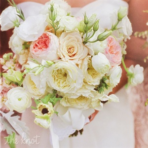 Lisianthus stems added a vintage touch to Lindsey's bouquet of garden roses, anemones and ranunculus.
