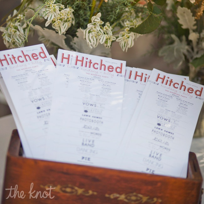 The graphic ceremony programs, designed by the bride, were printed on card stock and displayed in an antique apothecary drawer.
