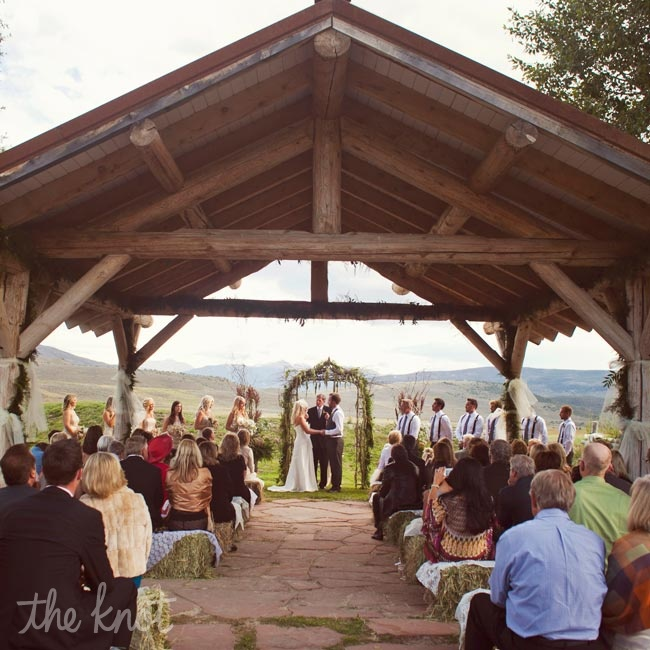 An ethereal arch adorned in greenery framed Lindsey and Billy as they exchanged vows with Vail Valley in the background.