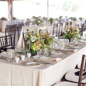 White terra-cotta pots turned votives, wooden planters and Mason jars brought homespun charm to the dining room.