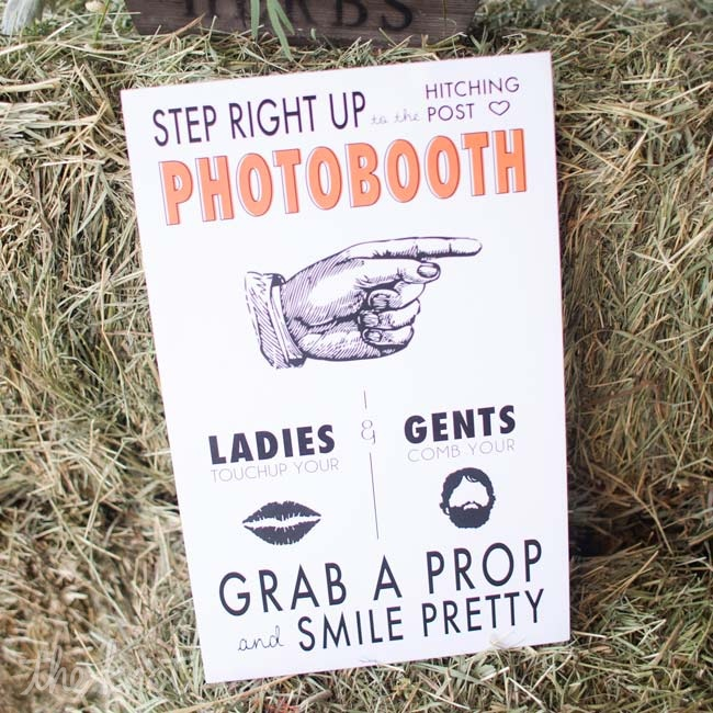 Guests posed with cowboy-themed props in the couple's quirky photo booth.