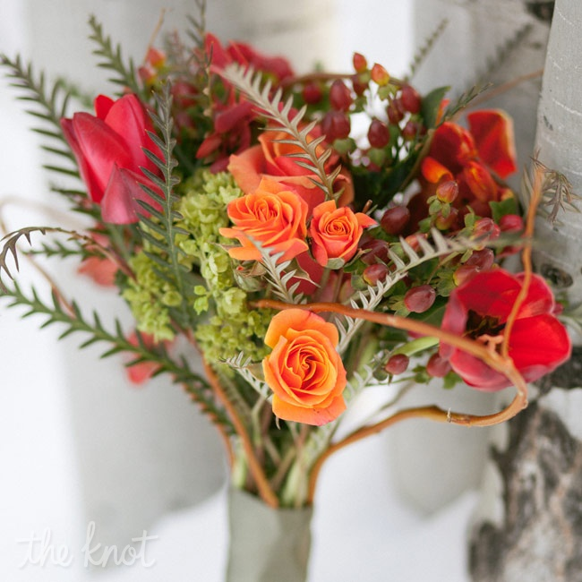 Spiky grevillea foliage combined with roses, tulips and hypericum berries brought a welcome touch of color to the otherwise neutral palette.