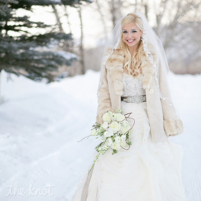 Natalie's frothy ballgown and fur coat played up the winter-wonderland-inspired destination wedding.