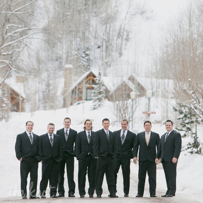 The groomsmen wore matching black tuxes with white shirts, pewter vests and medallion-print ties.