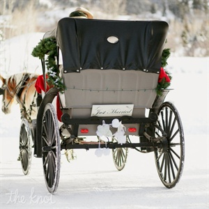 A romantic horse-drawn carriage befitting the ski chalet setting whisked the couple away.