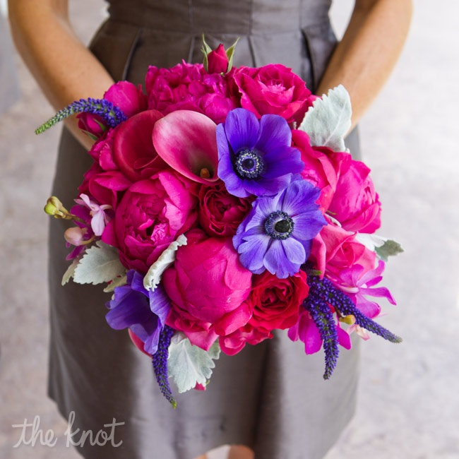 All eyes were on the maids' vibrant fuchsia and purple bouquets, which stood out against their pewter dresses.