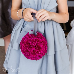 For a contemporary twist, Shannon&#39;s flower girl carried a bright floral pomander in place of scattering petals.
