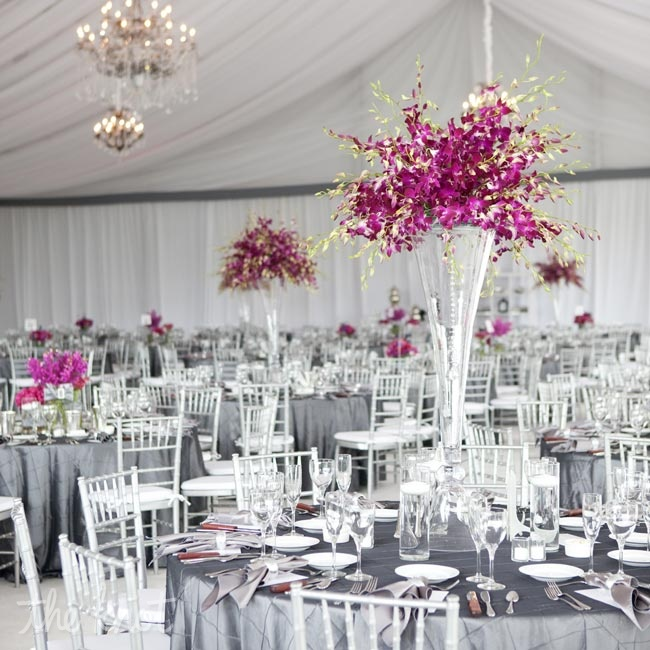 Lighting in shades of purple and pink warmed up the all-white tent while accentuating the colorful centerpieces.
