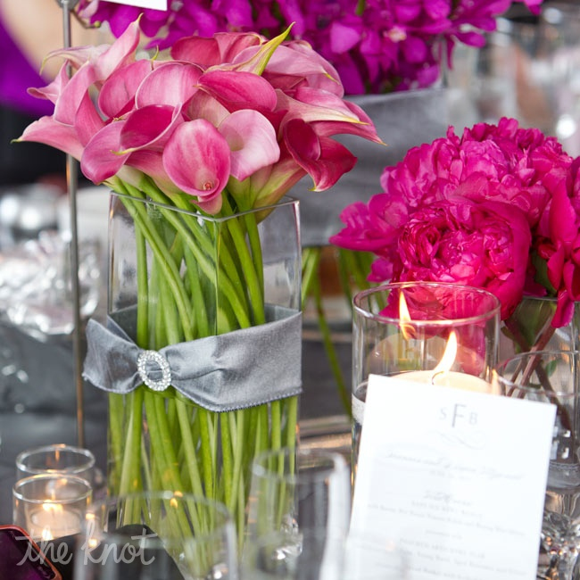 To create design consistency, blooms from the bouquets reappeared on the reception tables in sleek glass vases.