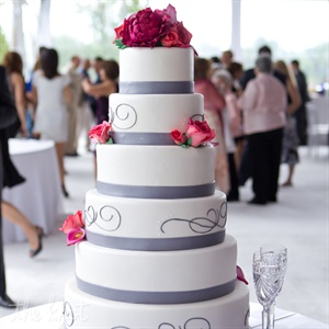 A custom-designed swirl that first showed up on the invites carried over onto everything from the dance floor to the modern cake.
