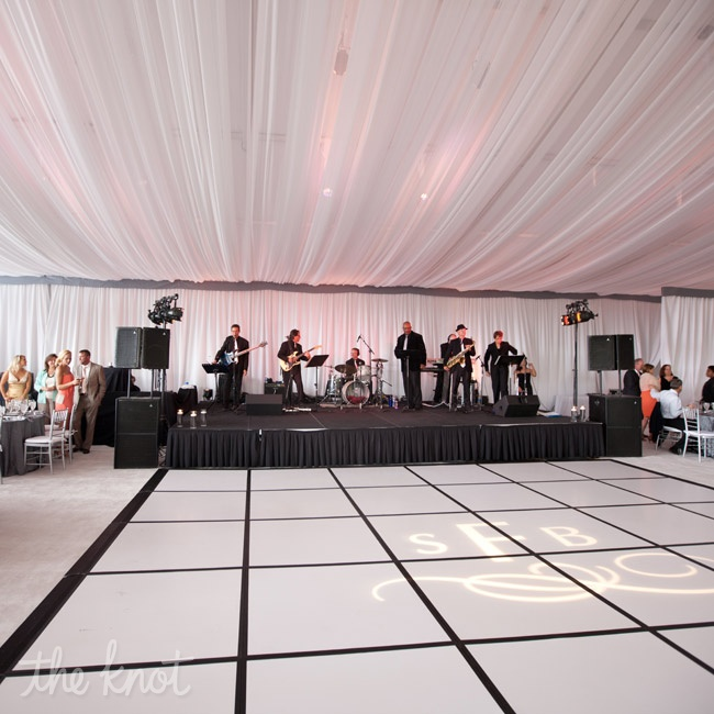 The white draping added drama to the elegantly decorated reception tent.