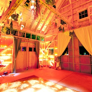 The reception took place in a small, white barn on the vineyard grounds. Lauren and Mike wanted to replicate the feel of an old drying shed that they once came across while driving through the Qu&#233;bec countryside, so their florist hung hand-dried flowers including tea and garden roses, larkspur, coxcomb, hydrangea, delphinium, and nigella pods fro ...