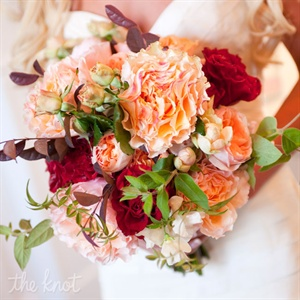 Lauren&#39;s red and peach bouquet consisted of David Austin English garden roses, Black Magic roses, and lambs ear tied with an ivory silk ribbon.
