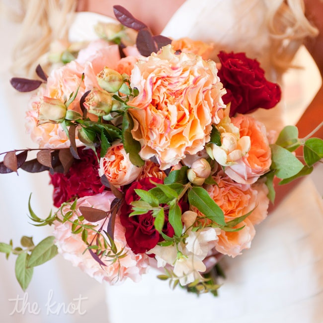 Lauren's red and peach bouquet consisted of David Austin English garden roses, Black Magic roses, and lamb's ear tied with an ivory silk ribbon.