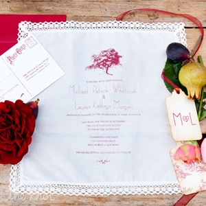 Lauren and Mike wanted their wedding to be as paperless as possible, and to give their guests something keepsake worthy, so they chose handkerchief wedding invites. The Charlestonesque country manor lace hankies and the vintage-style postcard RSVPs, which were printed on plantable paper, featured a likeness of the oak tree under which we were marri ...