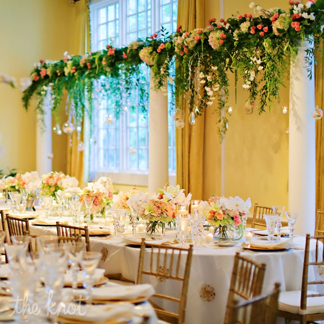 For the centerpieces Danae and Michael added greenery that resembled weeping willow in the high and low centerpieces at each table. The tables were covered in custom linens made with intricate gold motifs with matching napkins.