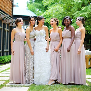 Danae's two sisters, new sister-in-law and two best friends served as her bridesmaids. All of the bridesmaids wore matching floor-length gowns while Danae's Maid of Honor wore a floor-length lace gown with a sash to match the other bridesmaids' dresses.