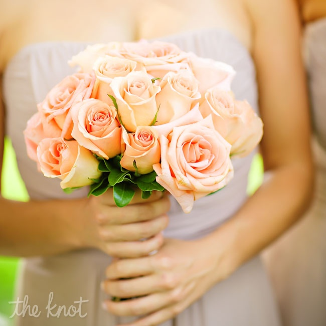 Danae's bridesmaids carried bouquets of peach roses, which complimented their champagne pink dresses.