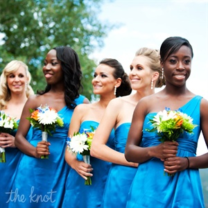 The bright blue of the one-shoulder dresses echoed the Colorado sky.