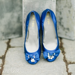 "For her ""something blue,"" Dana wore blue flats with pearls on the toes."
