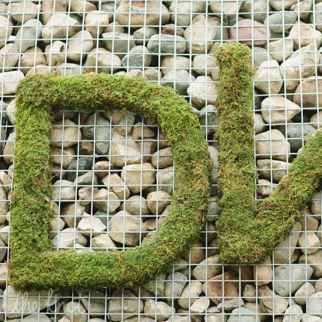 Dana and Whit's initials were displayed in moss as guests entered the venue.