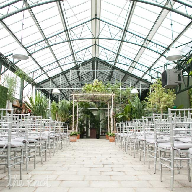 Because natural light and greenery filled the space, the couple only needed to add silver chiavari chairs and a wood huppah.