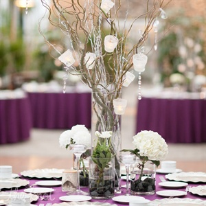 Tall vases filled with manzanita branches were surrounded by mini arrangements of white dahlias and hydrangeas.