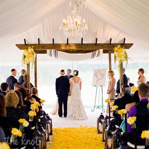 Jen and Phil exchanged vows inside a white tent next to a lake on the property.