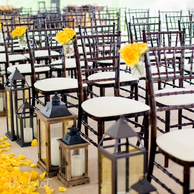 Large and small lanterns marked the end of each row, while a blanket of yellow petals decorated the aisle.