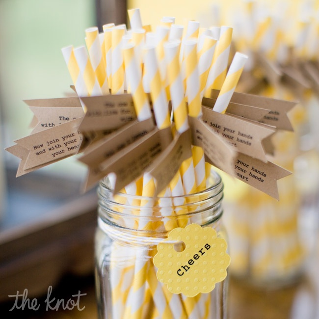 Guests sipped cocktails from Mason jars; yellow-and-white-striped straws were wrapped with flags adorned with cute sayings.